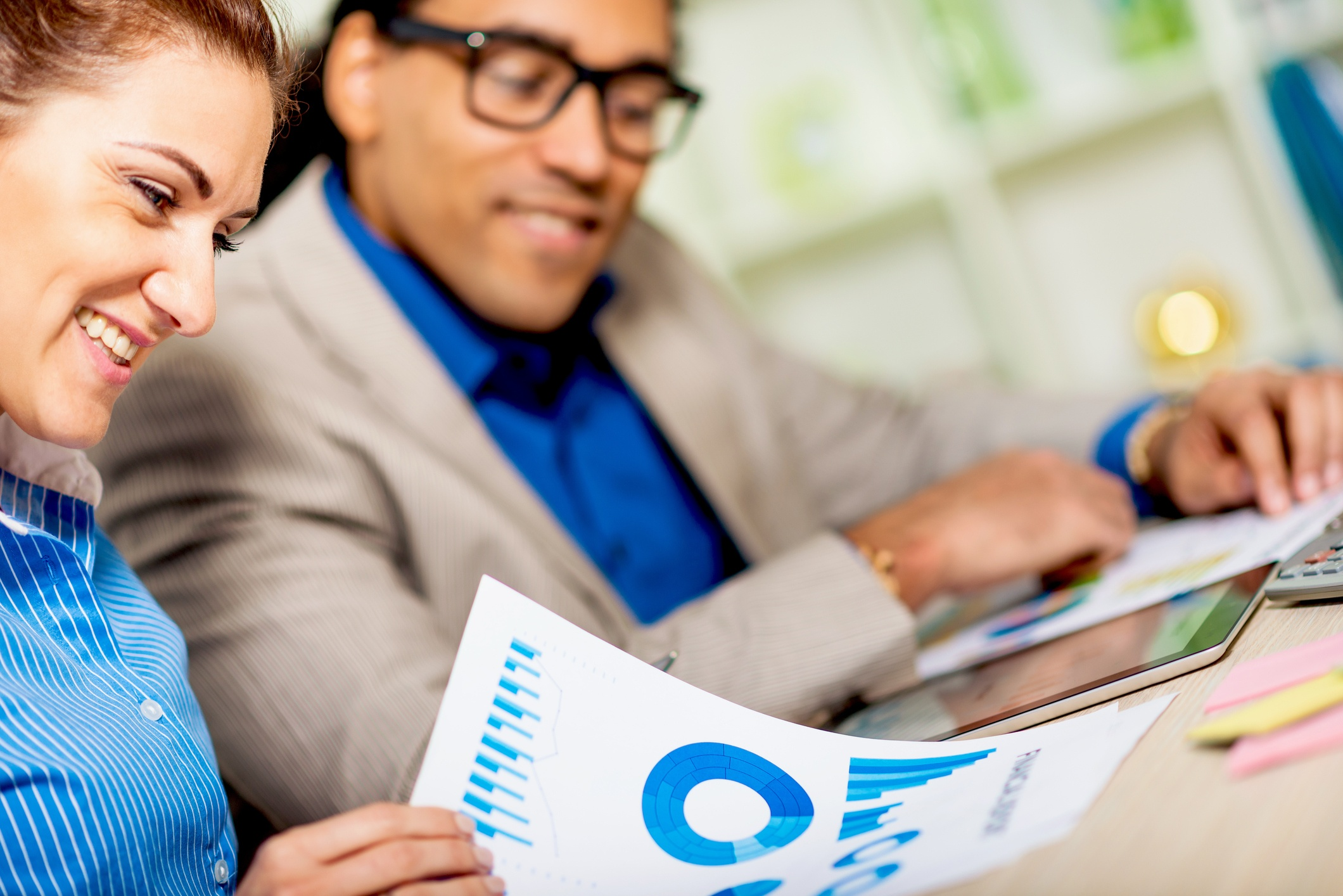 woman and man looking over reports.jpg